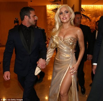Lady Gaga in custom gold gown.